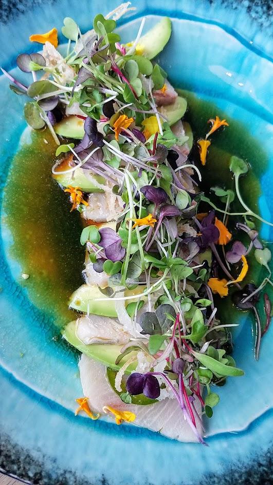 Hamachi Jalapeno Sashimi from Afuri, with yellowtail, avocado, jalapeno, housemade yuzukosho vinaigrette, micro greens, and fried shallots
