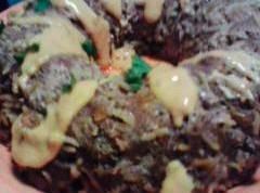 Let meatloaf rest for 10 min. Flip onto plate. melt cheese sauce and drizzel...