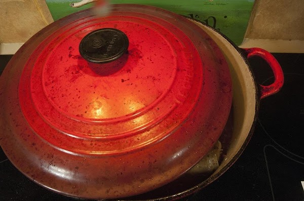 Partially cover the sauté pan with the lid.