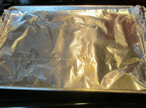 Line a shallow pan with foil for easy clean up, then spray with non...