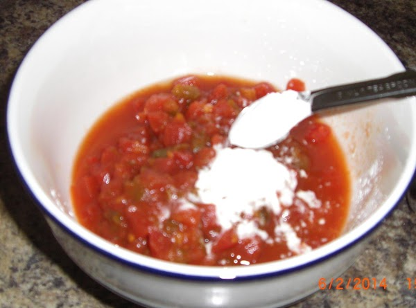 Mix together the tomatoes and cornstarch, add to beef.
