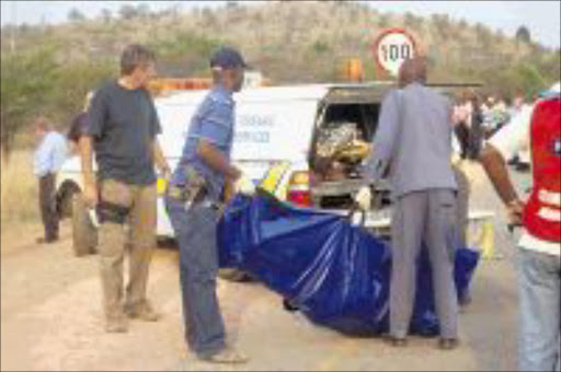 DEAD END: Six would-be robbers were gunned down in Kameeldrift in northeastern Pretoria after they tried to hijack a cash-in-transit van yesterday. Three of the robbers escaped in a getaway car and the six bodies of those killed were loaded into a forensic van. Pic: PEGGY NKOMO. 14/09/2009. © Sowetan.