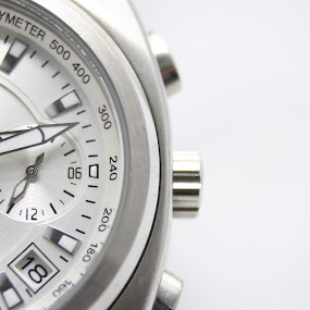 Close-up of a Watch by Beng Lim - Products & Objects Technology Objects ( meter, time, measure, watch, sport, white background, night, day, timing, measurement )