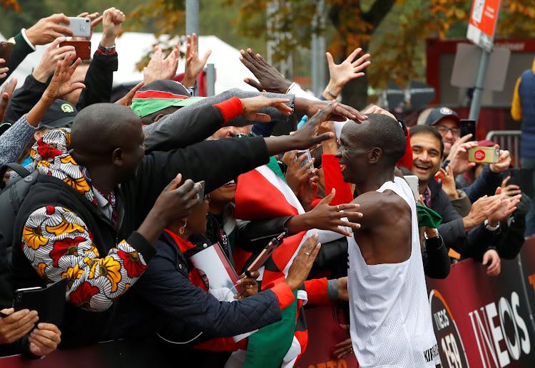 Eliud Kipchoge, the marathon world record holder, celebrates after a successful attempt to run a marathon in under two hours in Vienna, Austria, October 12, 2019.