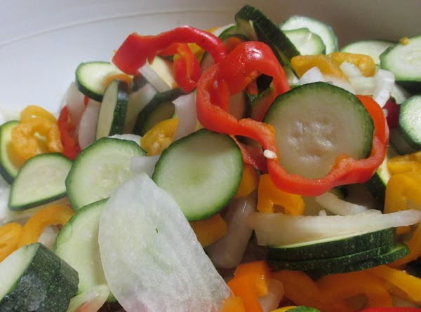 Chop peppers into rings, and add to bowl.