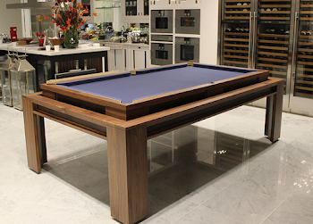 Pool table on tile flooring in a home dining area