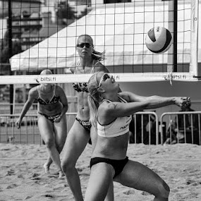 Beach volley by Simo Järvinen - Black & White Sports ( playing, ball, monochrome, outdoor, action, sports, game, females, women )