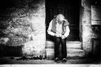 Photo: Man Sketching in Uzès  After spending the day walking around the old market, I started to walk back to where I started. Weaving through small alleys, I would occasionally enter larger courtyards. In one of them, I saw this man, sitting on a step, and sketching the scene.  When I took the photo, he looked up and gave a little smile, then went back to his business.  from Trey Ratcliff at http://www.StuckInCustoms.com