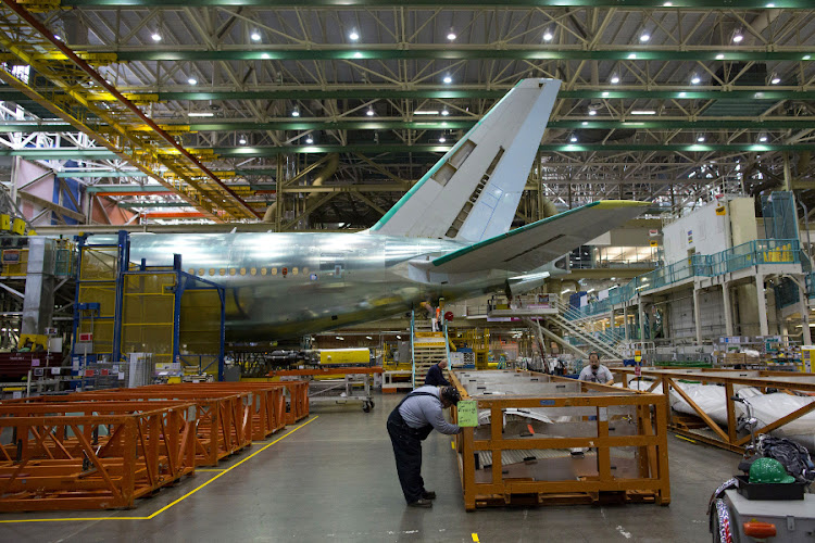 A Boeing 777 reaches the end of a production line at the company's facility in Everett, Washington. Picture: BLOOMBERG