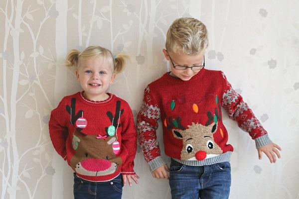 Cute blonde kids in Christmas jumpers
