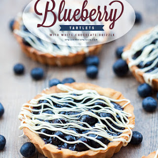Blueberry Tartlets with White Chocolate Drizzle.