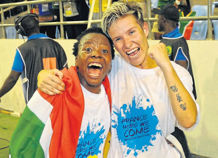 Goal achieved: Goal scorer Thembi Kgatlana, left, and Banyana teammate Janine van Wyk celebrate SA's semifinal win over Mali. Picture: SYDNEY MAHLANGU/BACKPAGEPIX