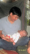 Photo: Jia Jan village: Gee with baby boy