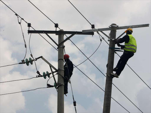 Kenya Power technicians repairs electricity line along the Likoni road in Nairobi on February 7. Disruptions lasting more than three hours will see affected customers compensated in proposed law by Parliament. The Energy Bill, 2015 is at the third reading stage Photo/FILE.