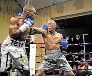Makazole Tete, left, and Gideon Buthelezi exchange jabs in their fight at the Orient Theatre recently.