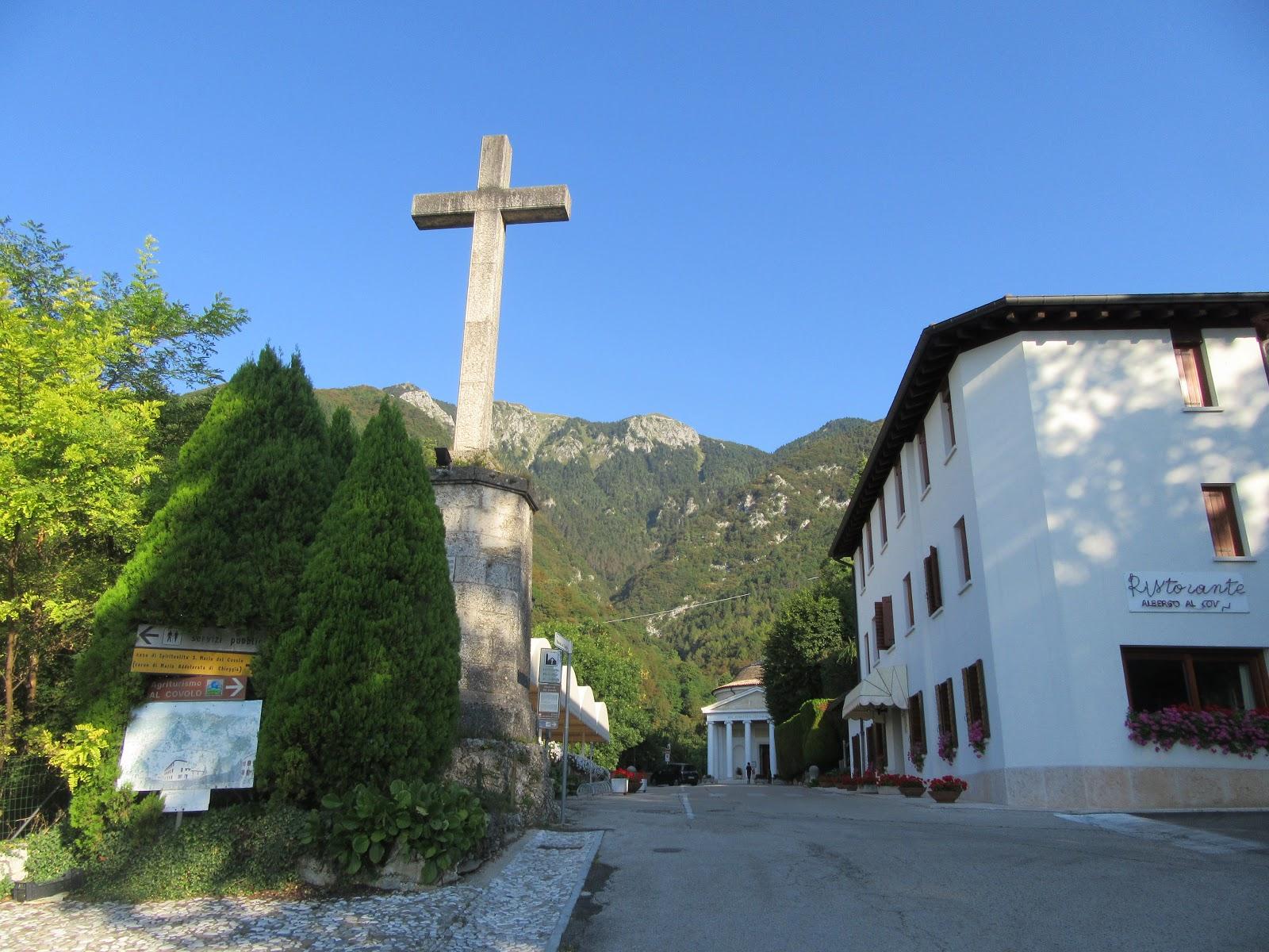 Bike climb of Monte Grappa from Crespano  - Santuario del Covolo, cross, mountain in background