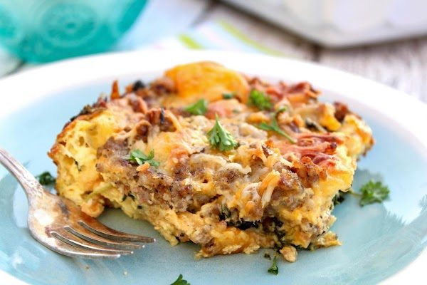 Piece of breakfast strata on a plate.