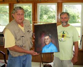 Photo: Dr. James Brown presenting Dr. Chris Carlton with a portrait.