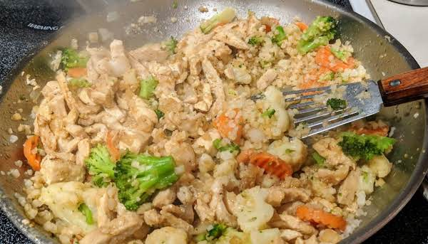 Frozen Veggies And Riced Cauliflower Is Cooked In The Same Skillet As Chicken Strips For A Great Dinner That Feeds 6. One Of Our Favs!