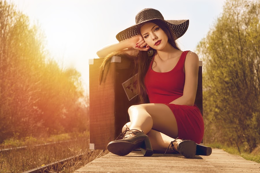 by Zoran Stamenkovic - People Portraits of Women ( girl, red, suitcase, dress, waiting )