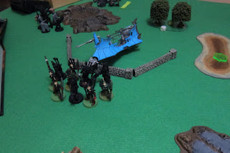 Photo: Turn 2 - end of Dark Angel turn - the HQ Raider carrying the Dark Eldar Archon (Warlord) and 9 Incubi (including the Klaivex (sergeant)) is wrecked, so the Dark Eldar must disembark immediately.