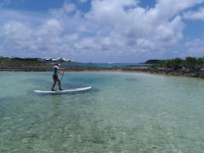 Photo: Anne practicing new stances on the paddle board with Tiloo Cut in the Background