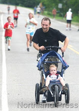 Photo: Michael Pfaff and his son Kenneth from Minneapolis participate in the Fun Run. Michael is the son of Larry Pfaff of Outing. - photo by Joanne Boblett