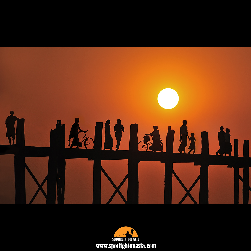 Photo: There are always people walking back and forth over U Bien Bridge at sunset. There are bicycle riders, Monks, locals and tourists and one must patiently wait for sufficient separation to get that great shot. The shot is hand held and taken from a rowing boat, so you must be mindful of your shutter speed. This is where my Nikon D700 works its magic, allowing me to shoot at higher ISO to get a faster shutter speed. With sunrise and sunset shots, I am not so bothered by any noise as this can easily be cleaned up in post processing and which not detract from the quality of the final image.