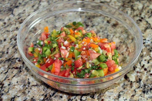 Prepare the fresh salsa by combining all ingredients in a bowl.