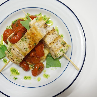 Grilled Swordfish Skewers with Sweet Tomatoes and Basil Oil.