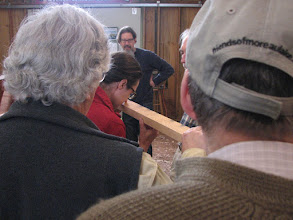 Photo: Jim explaining the characteristics of wood.  Sitka Spruce and Alaskan Cedar