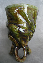 Photo: after glaze fire, you can see the iron rubbed in the carving through the clear green glaze.