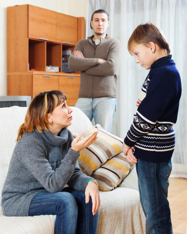 Mother and father scolding teenager Free Photo