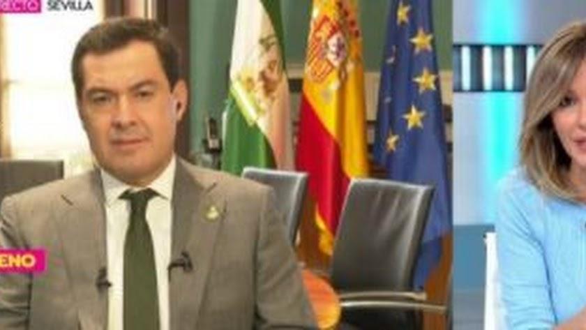 El presidente andaluz, Juanma Moreno, junto con la periodista Susana Griso.