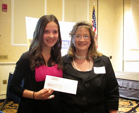 Photo: Kylee receiving the $1000 Grand Prize from the United Way's Star Project Competition from Karin Oliveira.