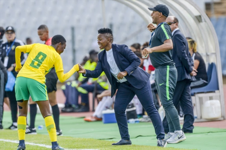 Karabo Dlamini of South Africa celebrates with coach Simphiwe Dludlu of South Africa after scoring a goal during the U17 World Cup Qualifier match between South Africa and Morocco at Dobsonville Stadium on February 04, 2018 in Johannesburg.