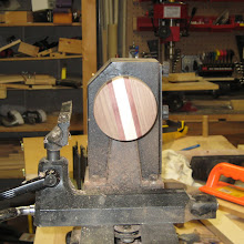 Photo: Rounding the bottom blank (I cut it out with my scrollsaw)