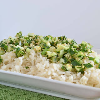 Warm Sesame Rice Salad with Cold Cucumber, Chive, and Lime.