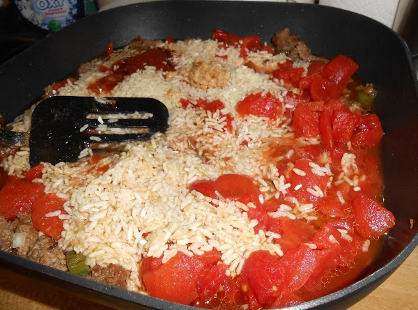 Add remaining ingredients except cheese. Fill empty tomato can with water and pour over...