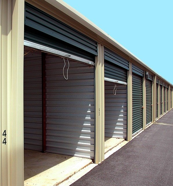 Self-storage units with their roll-up metal doors opened