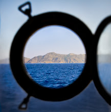 Photo: a version of truth  taken while sailing to a tiny island named Symi, in the Aegean Sea. This is one of the most beautiful islands I've ever seen, with a very well restored and highly interesting neo-classical Greek Architecture, next to some authentic examples of early 20th Century houses, many of them in the very state they were built: no modern addition, no signs of further conservation works. Just pure history.  for #WindowsWednesday, curated by +Simon Kitcher and +Jules Hunter
