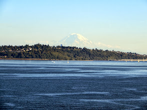 Photo: Nobly presiding over everything Seattle, including our departure, Mount Rainier appears almost cloud-like in the distance.