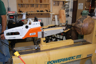 Photo: While the meeting was getting organized, a preview of both parts of the demo were on display on the lathe. A special thank you to the local Stihl representative Matt Cecil for loan of the electric chain saw and to Phil Brown for the large elm blank.