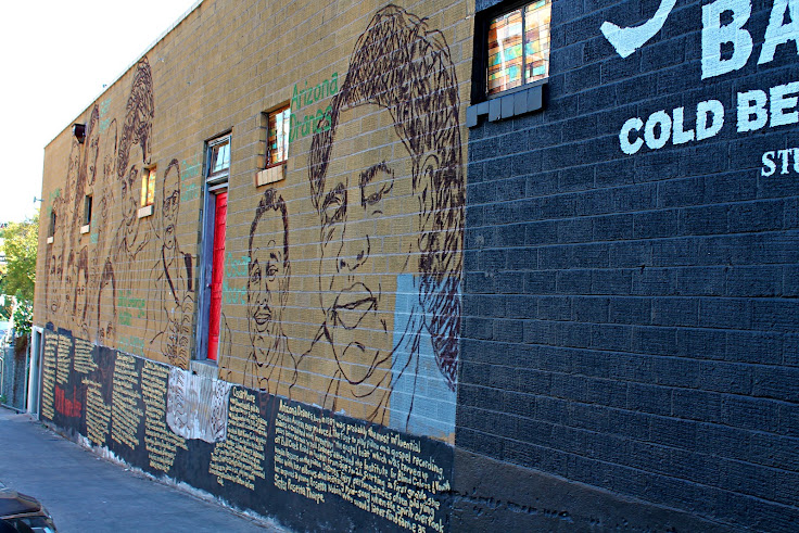 This mural features 8 local musicians.