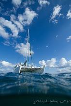 Photo: Over under image of catamaran in the Galapagos Islands, Ecuador.