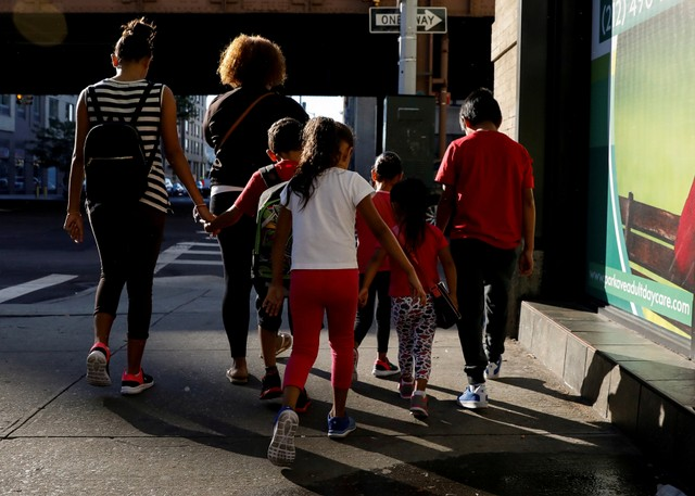 Children are escorted to the Cayuga Center, which provides foster care and other services to immigrant children separated from their families, in New York City, US.