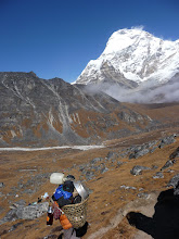 Photo: Porter in Hunku valley and Chamlang (7319m) behind