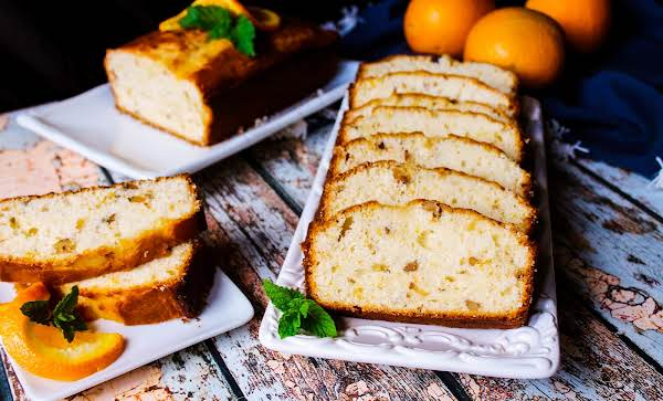 Slices Of Orange Cream Cheese Bread On A Plate.