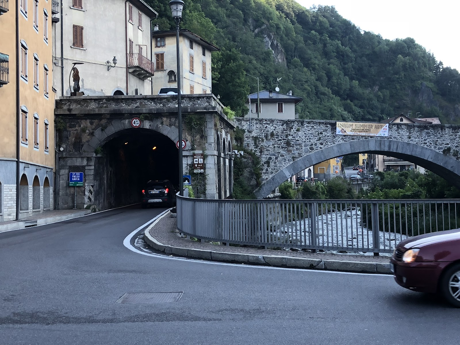 bike climb of Passo del Mortirolo from Edolo - start of climb - bridge in Edolo