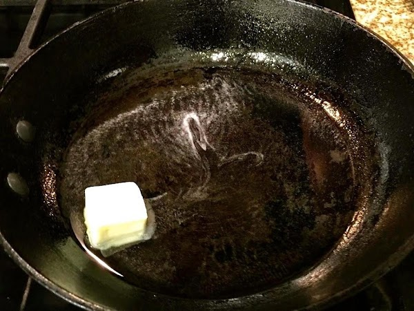 Heat 2 tablespoons butter and 2 tablespoons canola oil in a cast iron skillet...